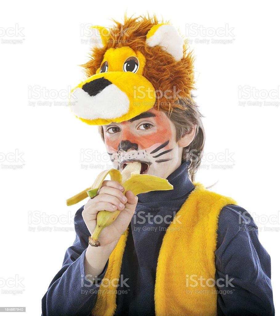 Boy as a lion with banana stock photo