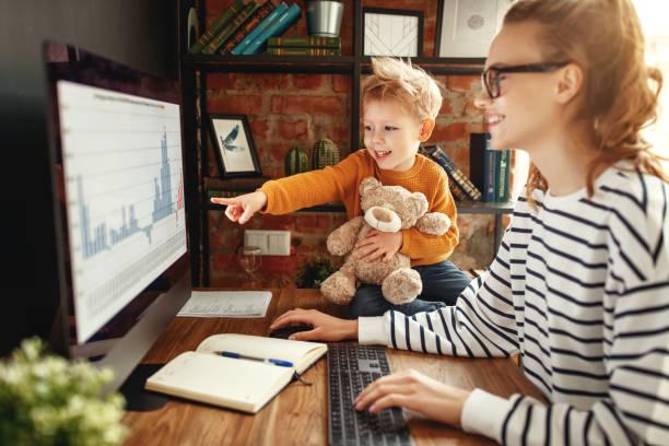boy asking mother about data analysis during work - remote work imagens e fotografias de stock