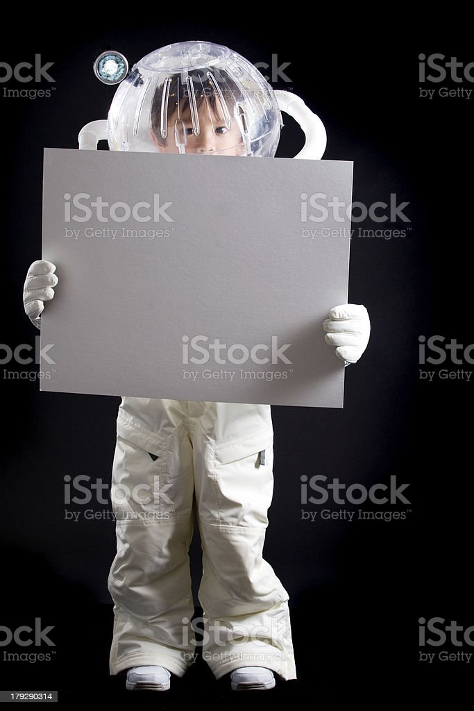 Boy Astronaut with Blank Sign stock photo