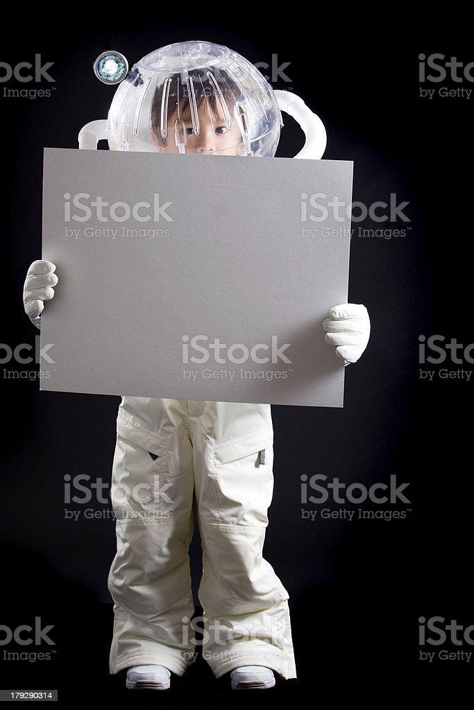 Ragazzo astronauta con vuoto segno - foto stock
