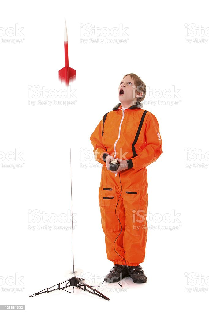 boy astronaut with flying model rocket royalty-free stock photo