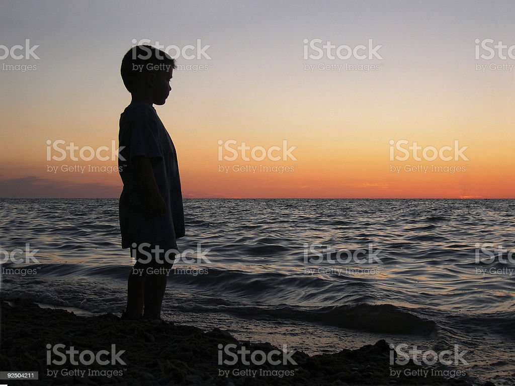 Boy at Beach Sunset royalty-free stock photo