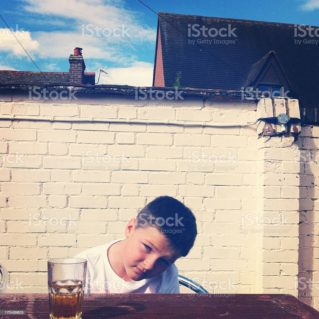 Boy at English pub garden royalty-free stock photo