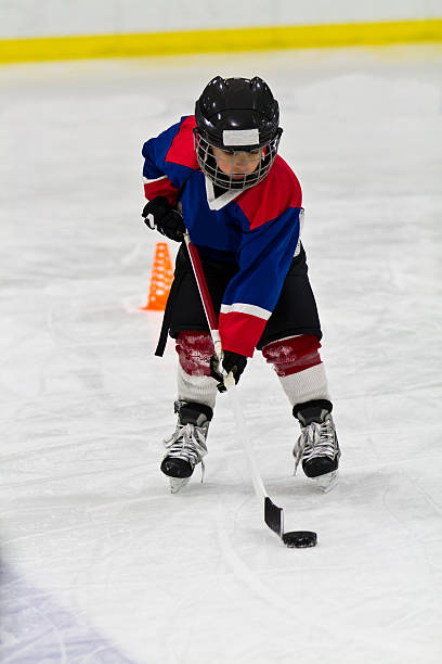 Boy at ice hockey practice stock photo