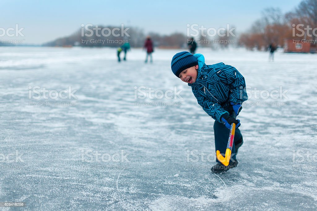 Boy at ice hockey practice stock photo