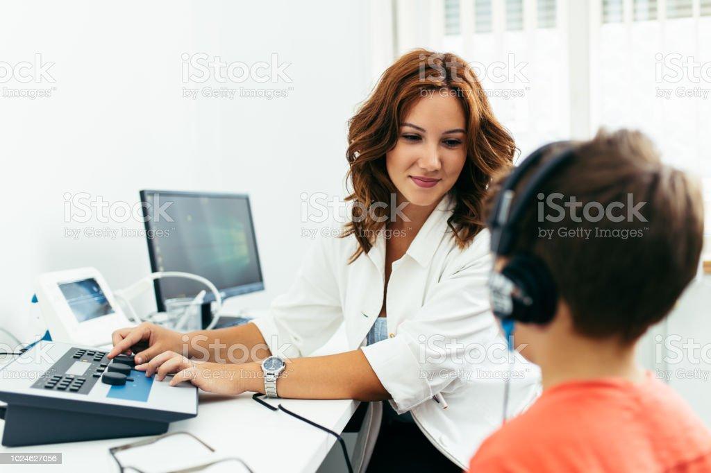 Boy at medical ears examination stock photo