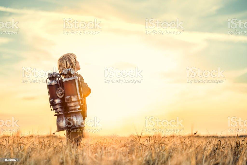 Boy at sunset stock photo