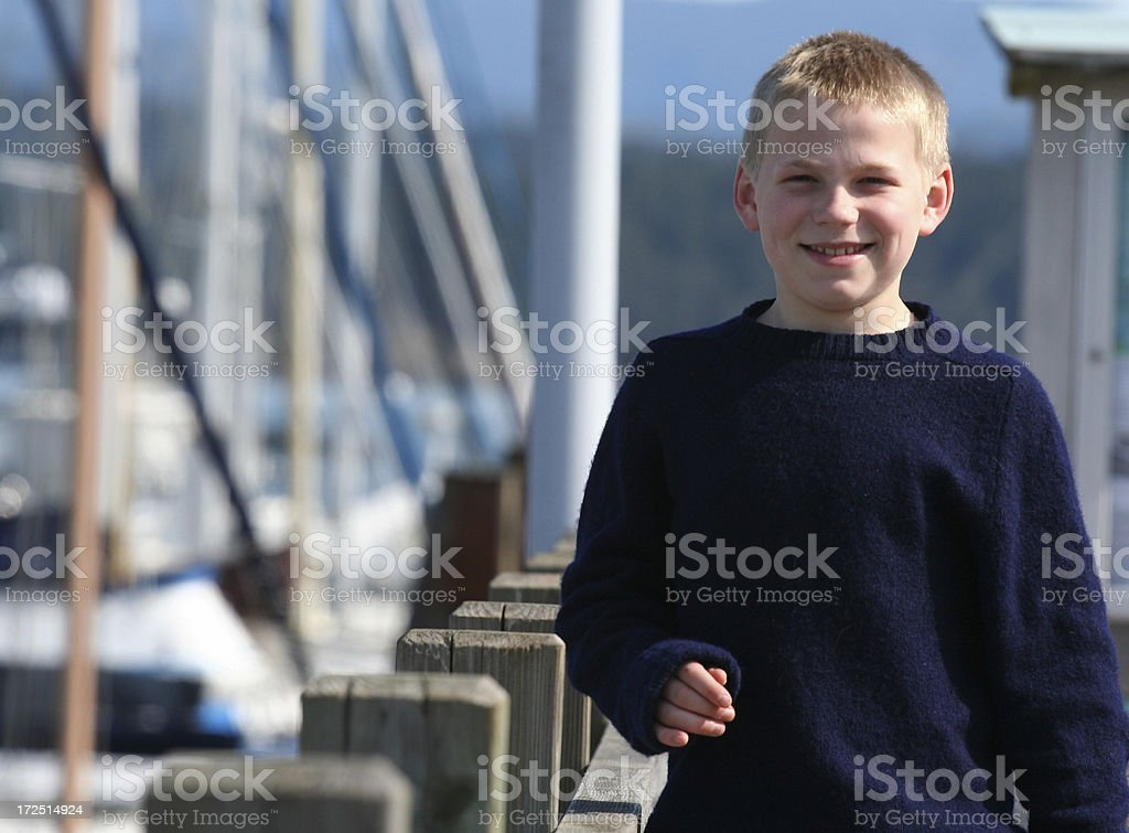Boy At The Docks royalty-free stock photo