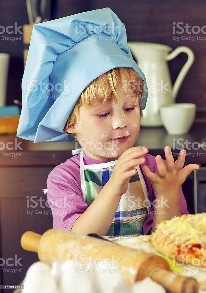 Boy at the kitchen royalty-free stock photo
