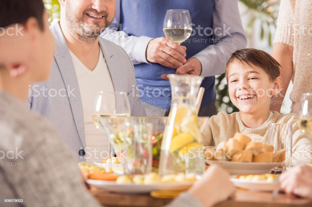 Boy at the table stock photo