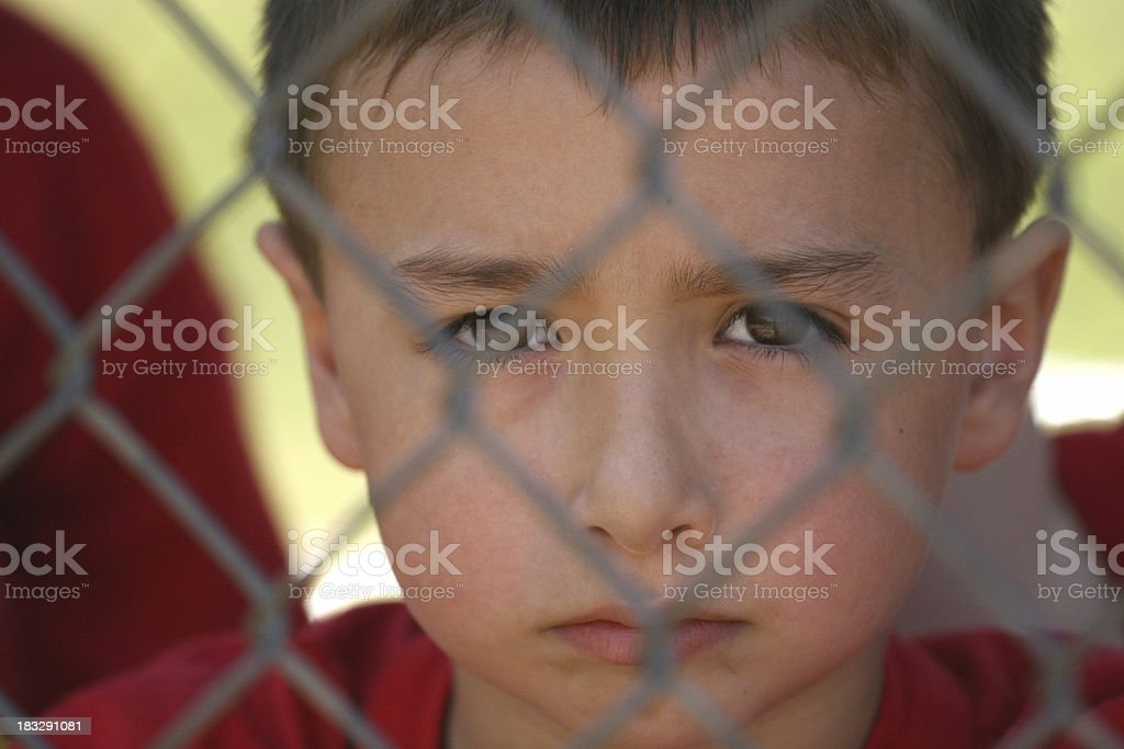 Boy behind fence royalty-free stock photo