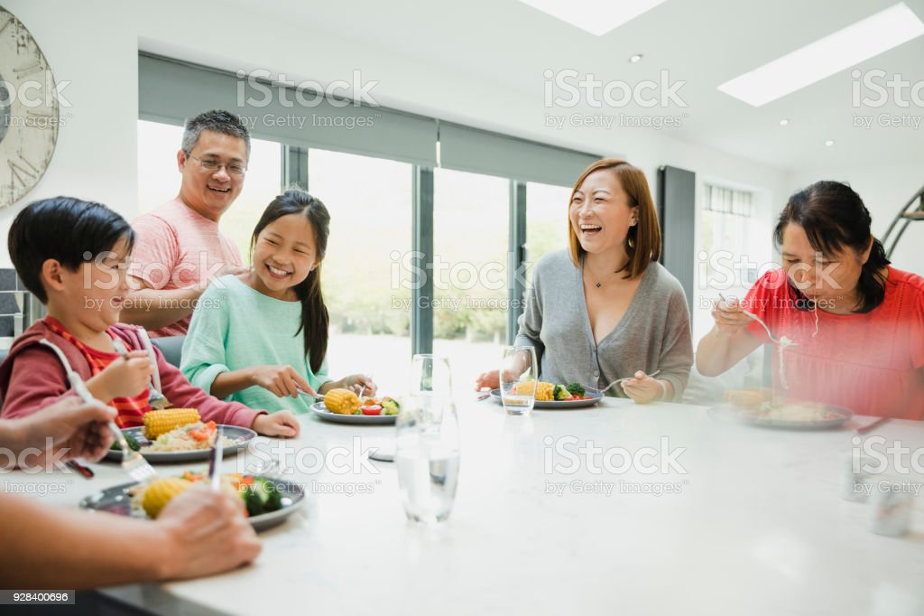 Boy Being Silly at the Family Dinner stock photo