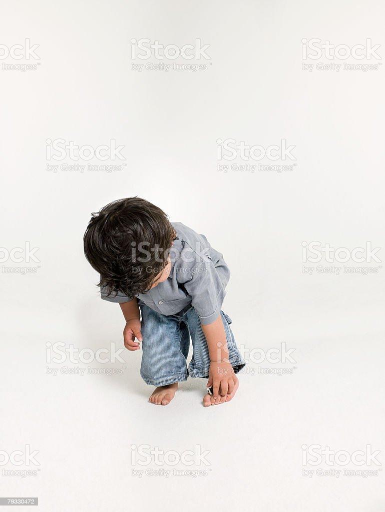 A boy bending over 免版稅 stock photo