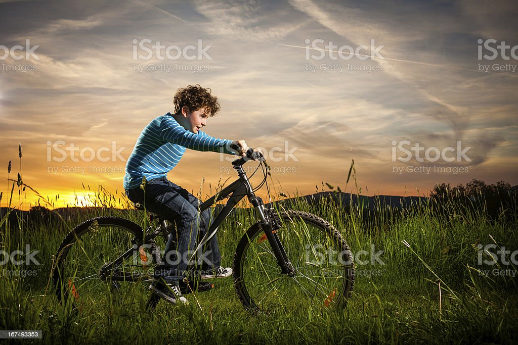 Boy biking royalty-free stock photo