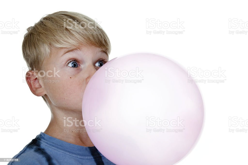 Boy blowing a big bubble stock photo