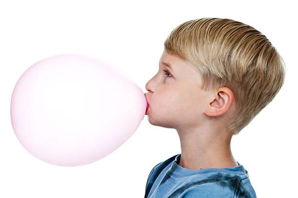 Boy blowing a bubble stock photo