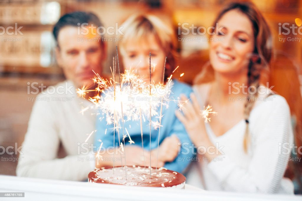 Boy blowing out the candles stock photo