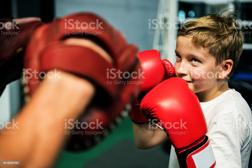 Boy Boxing Training Punch Mitts Exercise Concept stock photo