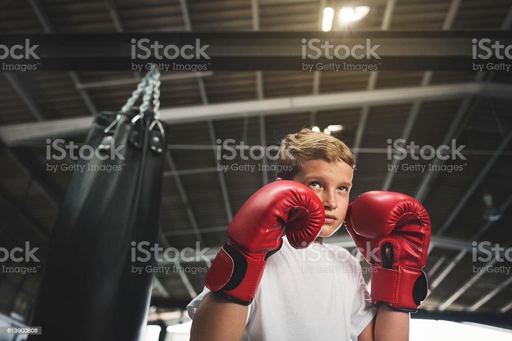 Boy Boxing Training Punching Bag Exercise Concept stock photo