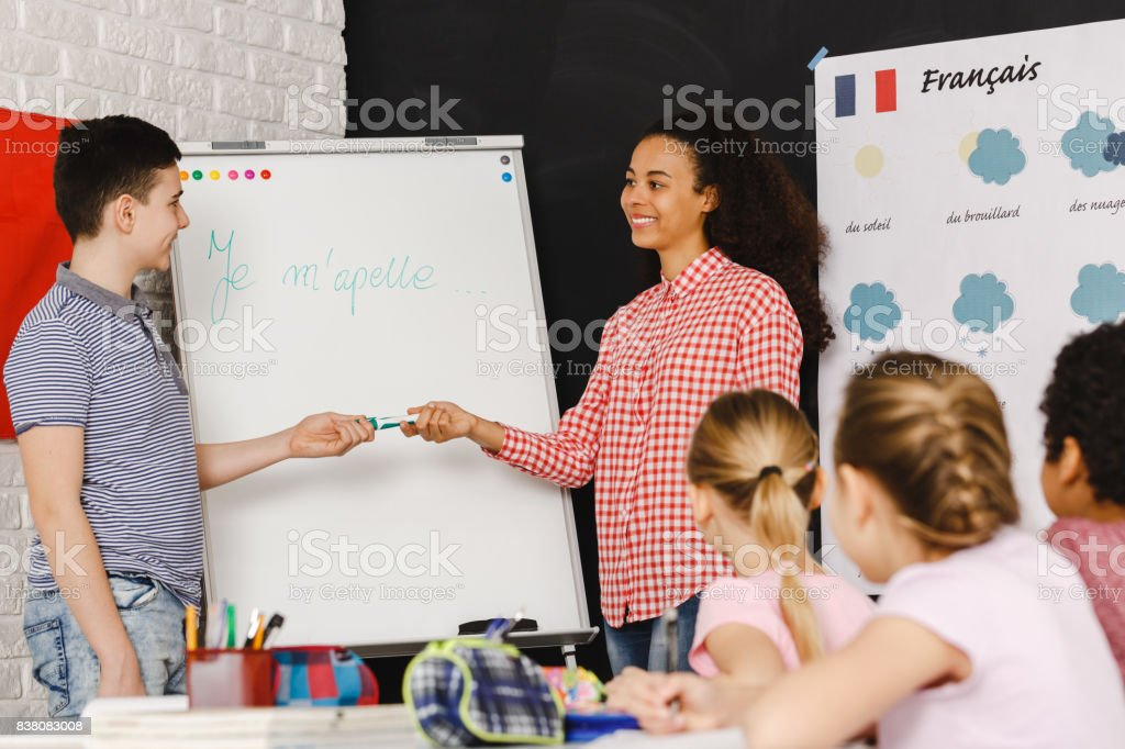 Boy by the board stock photo