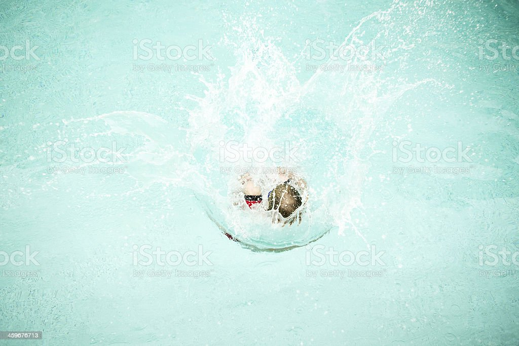 Boy Canon Ball Jumping into a Swimming Pool stock photo