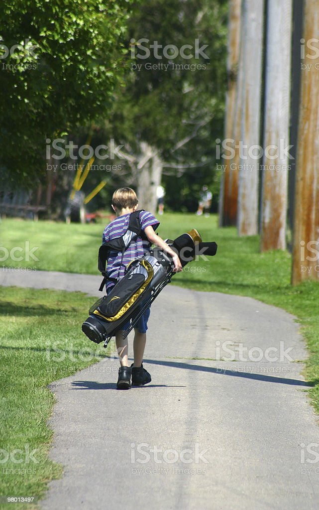 Boy Carrying Bag royalty-free stock photo