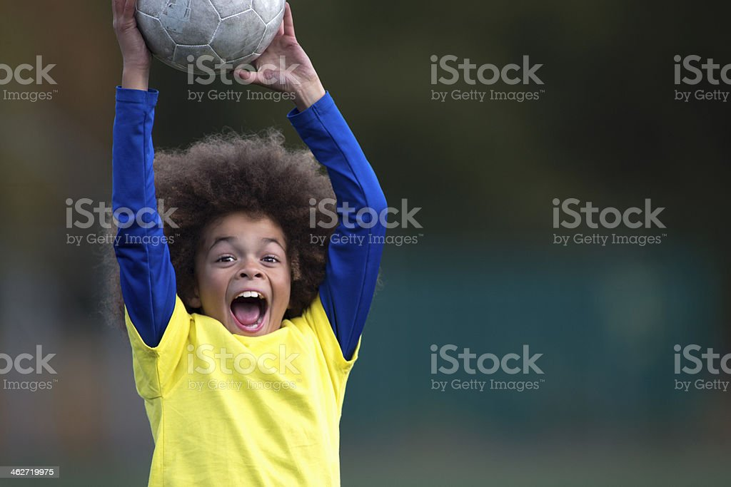 Boy Catching A Football stock photo