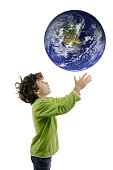 Boy catching falling planet Earth, on white background.
