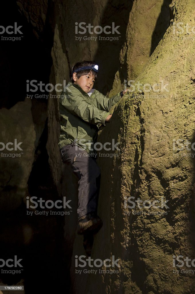 Boy caving in Thor's cavern, derbyshire royalty-free stock photo