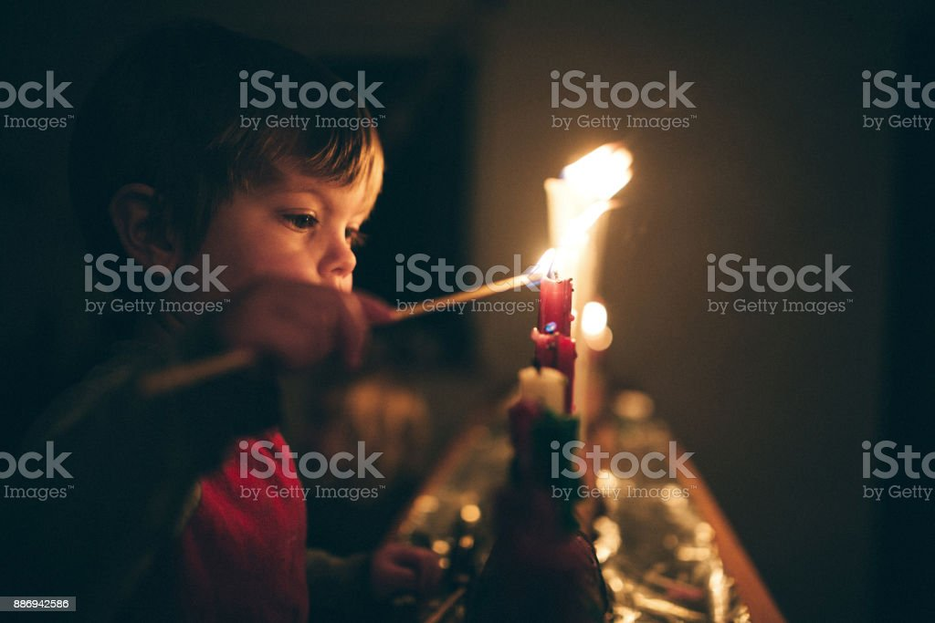Boy Celebrating Advent Holiday With Candles stock photo