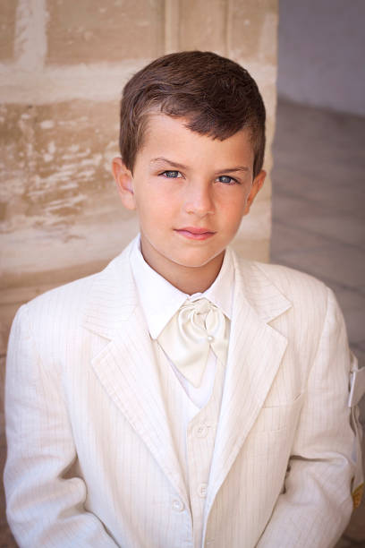 boy celebrating first communion - communion stock photos and pictures