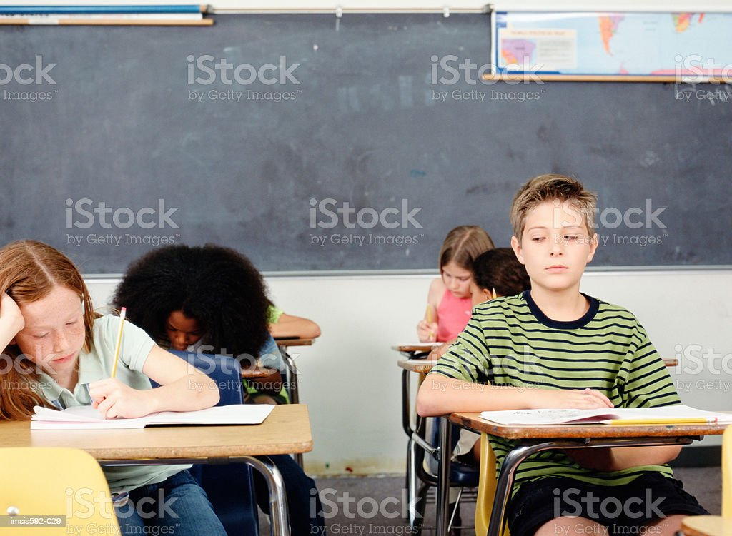 Boy cheating in examination 免版稅 stock photo