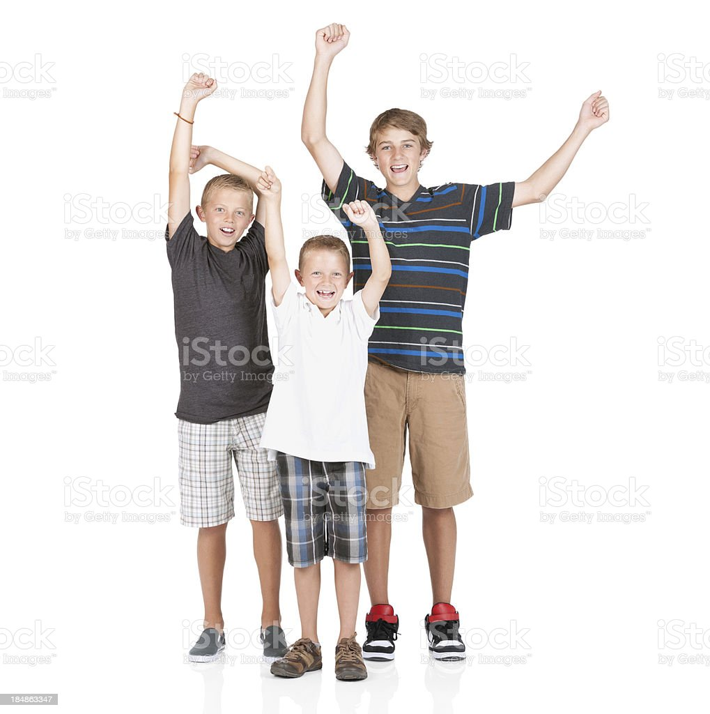 Boy cheering with his brothers royalty-free stock photo