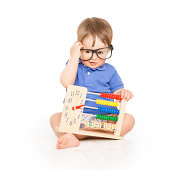 Boy child with abacus clock in glasses counting, smart little kid study lesson, education concept