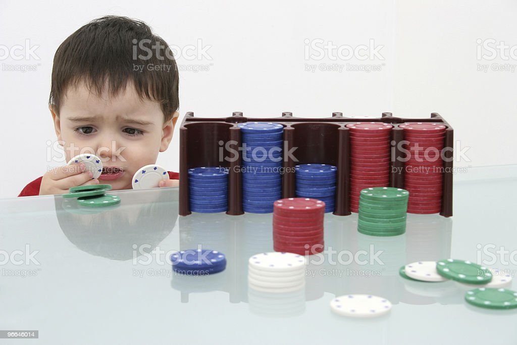 Boy Child Playing with Poker Chips royalty-free stock photo
