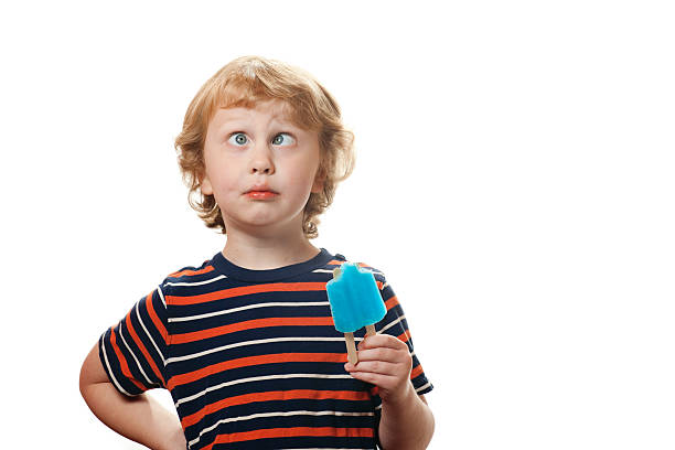boy child with popsicle - nerd boy eating stock photos and pictures