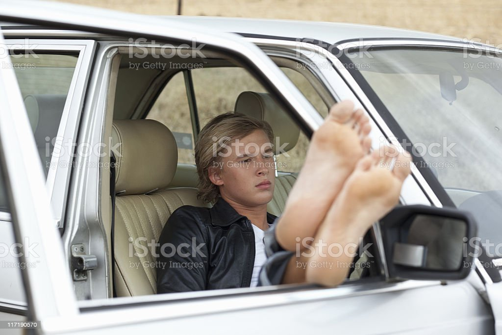 Boy chilling in the car stock photo