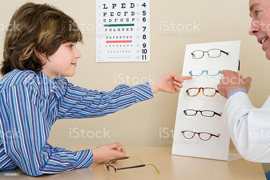 A boy choosing glasses royalty-free stock photo