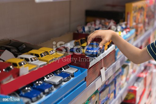 Boy choosing toy in the shop