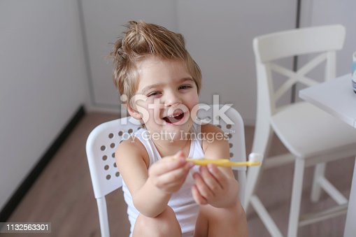 948443044istockphoto Boy cleans his teeth in the morning and plays with a toothbrush 1132563301