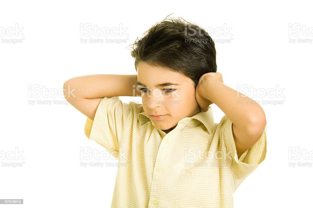 Boy closing his ears royalty-free stock photo