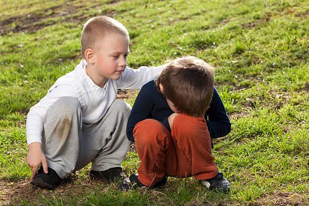 Boy comforts a friend. stock photo