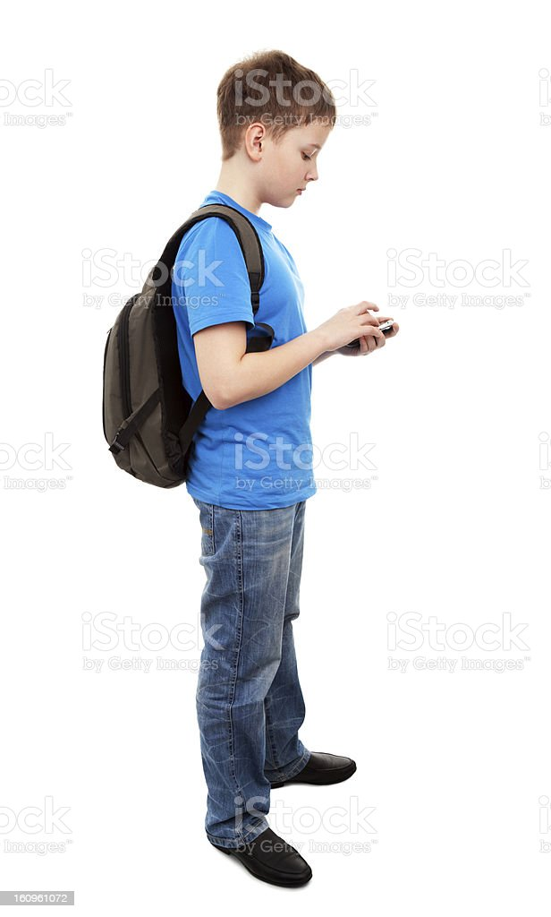 Boy concentrated sending a Text Message. stock photo