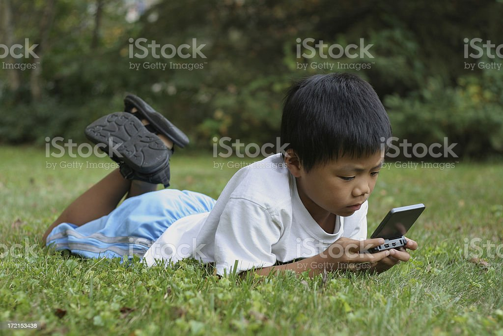 Boy concentrating on a video game stock photo