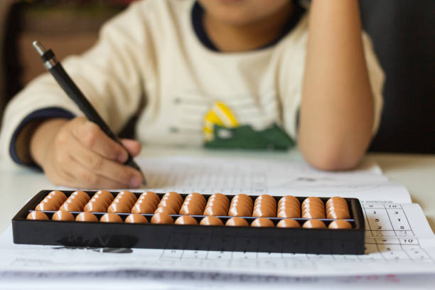 Boy counts with abacus in school. Japanese abacus.Boy counts with abacus in school. abacus stock pictures, royalty-free photos & images
