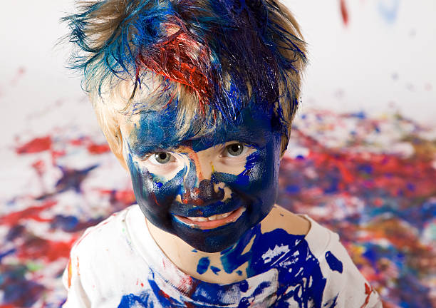 Boy Covered with Paint stock photo