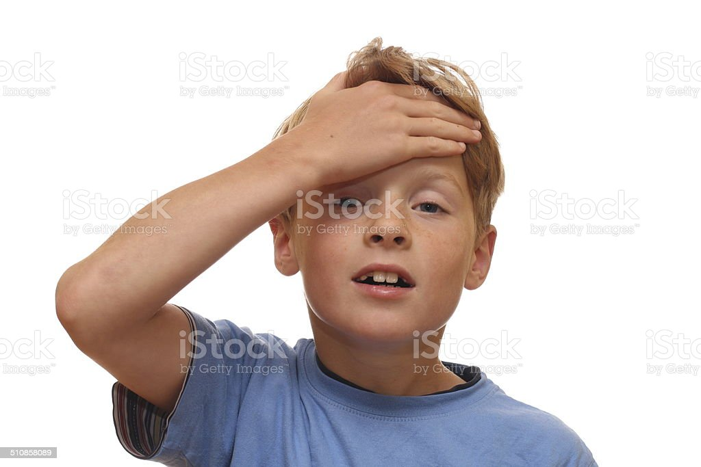Boy covers his forehead stock photo