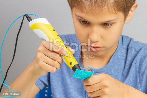 899701486 istock photo Boy creating with 3d pen new object 1191894670