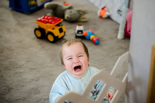 Boy crying in Living room stock photo