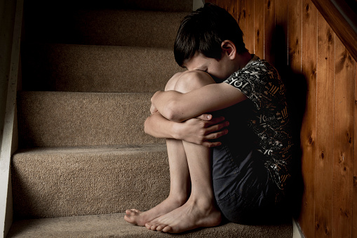 istock Boy Crying Sitting on Stairs 495841132